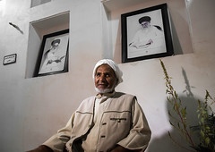 old bandari sailor in front of khameini and khomeini portraits in a house, Hormozgan, Bandar-e Kong, Iran (Eric Lafforgue) Tags: portrait people man men senior horizontal photography asia sitting iran propaganda muslim islam persia kong indoors human iranian sailor adults adultsonly oneperson middleeastern persiangulf sunni ayatollah menonly seniorman khomeini hormozgan 50sadult  bandari onemanonly waistup  1people  iro straitofhormuz  colourpicture bandarekong  irandsc05503