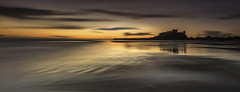 Stronghold (Pureo) Tags: beach water clouds sunrise canon landscape sand northumberland le northsea northeast waterscape bamburghcastle leefilters canon6d