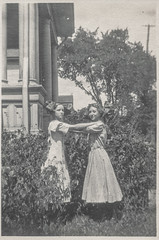 Two girls holding each other (simpleinsomnia) Tags: old white black girl monochrome yard vintage found outside blackwhite holding antique snapshot front photograph vernacular frontyard adolescent foundphotograph embracing