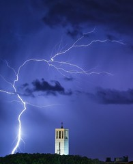 The lightning and the church [EXPLORED] (Alessandro Cuomo) Tags: longexposure sky italy building church nature weather clouds photography flickr italia natura chiesa cielo thunderstorm lightning fotografia townscape temporale sabaudia fulmine tamron70300mm lungaesposizione canoneos600d