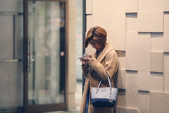Texting ([~Bryan~]) Tags: street city people woman lady night tokyo waiting candid shibuya streetphotography cinematic texting 135l