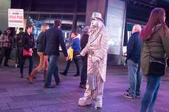 Silver Mime (UrbanphotoZ) Tags: nyc newyorkcity ny newyork hat night silver mask manhattan bowtie can midtown timessquare pedestrians westside sequins tux mime sparkling irishpub tails platforms odonoghues cummerbund wraparounds tipcontainer