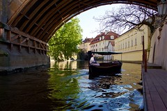 Little Venice in Prague (Eric Luesink) Tags: old bridge venice man colour reflection tree castle water ferry facade sailboat river boats boat dock support break tour czech prague scenic charles tourist adventure czechrepublic cz sailor passage cascade waterway czechia woodboat facad charlesbride