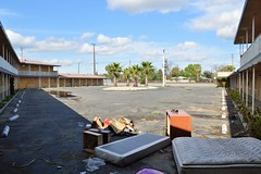 The Holiday is Over (rickele) Tags: fresno vacant boardedup mattress outofbusiness vintagesign illegaldumping livedin holidaymotel slatedfordemolition moteldrive weeklyrates oldus99 usroute99