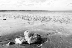 You'll never find gold on a sandy beach (OR_U) Tags: uk sea blackandwhite bw 3 beach water wales landscape coast three blackwhite rocks bokeh minimal oru minimalism schwarzweiss meatloaf anglesey 2016
