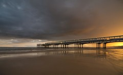 That Golden Touch (Dropping light photography) Tags: uk sunset sea england colour beach water rain clouds golden dorset boscombe