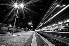 at the station VII (Zesk MF) Tags: bw white black train dark moving movement nikon nacht tracks db line trail lantern 8mm trier longtime langzeit zesk railpassion