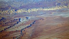 2016_02_10_sba-lax-ewr_512 (dsearls) Tags: red orange snow mountains utah flying desert wind aviation united aerial erosion plains sanrafaelswell ual unitedairlines windowseat windowshot 20160210 sbalaxewr