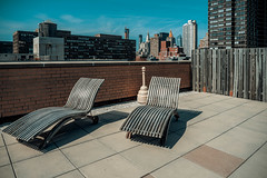 Up on the Roof (Jeffrey) Tags: city nyc newyorkcity roof urban newyork building rooftop architecture buildings spring chair apartments chairs manhattan lounge deck condo eastriver roofdeck condos eastside residential residences