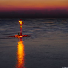 Island (Erik Schepers) Tags: light sunset sea people lighthouse river surreal guide mast unreal guiding