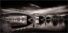 Barnes Railway Bridge (Robert Bilinski) Tags: longexposure bridge reflection london eye monochrome thames canon river eos tide low railway barnes bnw nisi 1635mmf4 robbil robertbilinski