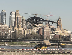 Helicopter Arriving and Departing Downtown Helipad In Manhattan With Brooklyn Heights In View (nrhodesphotos(the_eye_of_the_moment)) Tags: nyc cars glass metal architecture brooklyn waterfront outdoor manhattan sightseeing perspective tourist transportation eastriver helicopters blades rotor roadway helipad flyingmachines wwwflickrcomphotostheeyeofthemoment theeyeofthemoment21gmailcom dsc09718160