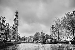 AmsterdamCruising, circa 2013. (mindtraveler26) Tags: travel blackandwhite netherlands amsterdam clouds canon buildings canal europe flickr dslr oldcity waterway nationalgeographic oldeurope traveler lightroom flickrtravel bestoftheday flickrblackandwhite