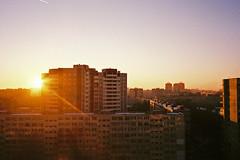 Sun goes down (adam sharp) Tags: winter sunset tower film home architecture 35mm stpetersburg photography living apartments russia olympus fujifilm blocks saintpetersburg superia400 mjuii stp filmphotography россия mju2 fujifilmsuperia μmjuii санктпетербу́рг