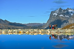 Happy hour  . The Fallbodensee and  at the Wetterhorn . Canton of Bern , Switzerland. No. 1470. (Izakigur) Tags: helvetia friends tourists reflection berneroberland bern berne berna kantonbern kleinescheidegg jungfrau alps alpes alpen alpi autumn lake lac swiss switzerland schweiz europe europa wetterhorn water eau topf25 topf300 acqua wasser