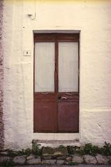 the doors #237 (.CLOSER.) Tags: city urban photography nikon doors 28mm elements porta af nikkor astratto arco f4 architettura closer testo analogic trama allaperto