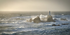 Riding out the storm (pa.herbert) Tags: sea lighthouse waves jersey channelislands corbiere
