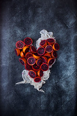 Blood Orange Heart (onegirlinthekitchen) Tags: red stilllife love vertical fruit canon 50mm raw heart juice nopeople topdown citrus oranges chiaroscuro valentinesday bloodorange vitamin foodphotography squeezing juicing foodstyling