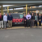 Students pose for a photo in front of a ROOT Sports van