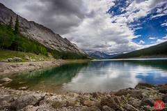 Peaceful (Kasia Sokulska (KasiaBasic)) Tags: summer lake canada mountains nature water reflections landscape rockies rocks shore alberta medicinelake jaspernp