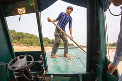 Our boatman digs us out of the mud! (amanda & allan) Tags: cambodia tonlsap