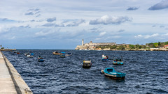 Fisher Boats in front of the Castillo de los Tres (www.dave.training) Tags: travel blue sea sky urban tourism monument america port religious bay harbor boat fisherman marine cityscape peace christ harbour space religion jesus havana cuba landmark scene maritime fisher tropical copyspace vacations socialism redeemer