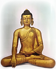 A Golden Buddha in a Lotus Position