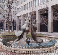 Mermaids play in dry fountain (stephenweir) Tags: toronto fountain threegraces mermaids baystreet bayst governmentbuilding geraldgladstone brokenfountain fauxfishart