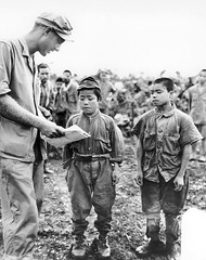 """Marine First Lieutenant Hart H. Spiegal of Topeka, Kansas, tries to communicate using sign language with two tiny Japanese soldiers captured on Okinawa. The boy on the left claimed to be """"18"""" while his companion boasts """"20"""" years, 17 June 1945. [1268x1600 (Histolines) Tags: boy two history sign june japanese marine with captured first retro using h tiny be his kansas timeline soldiers 17 hart while okinawa tries years language topeka left companion 1945 communicate claimed boasts the lieutenant spiegal vinatage historyporn """"20"""" """"18"""" histolines 1268x1600 httpifttt23qbdev"""