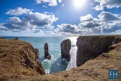 Stack Rocks (felix.hohlwegler) Tags: ocean greatbritain sea cliff sun wales clouds canon eos coast seaside rocks meer unitedkingdom britain outdoor united wolke kingdom sonne kste klippen 500d coastside stackrocks