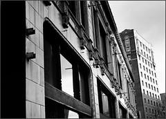Downtown Seattle 1 (@GilAegerter / klahini.com) Tags: seattle urban film architecture buildings nikon downtown ilfordxp2 ilford manualfocus urbanlandscape manuallens nikonn2000 50mmf18seriese gilaegerter