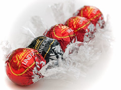 One of these things...is different to the rest...HMM! (kentishmayde) Tags: red black different chocolate odd hmm wrappers lindor lindt oddoneout oneofthesethings macromondays