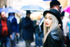 You under the rain (Anxhela Isaj) Tags: city red hat rain day makeup rainy lipstick umbrellas rosso pioggia citt capelli greyhair rossetto capello trucco ombrelli grigi