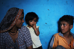 Little girl in slum vocational school with her Mum and brother (Idiomadd) Tags: poverty children happy community delhi poor slum colony namaste kathputli