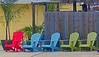 Colorful Chairs, Tarpon Springs (gg1electrice60) Tags: blue red green greek chairs woodenfence lawnchair spongedocks woodenchairs necorner northeastcorner woodenswing multiplecolors dodecaneseboulevard dodecaneseblvd pinellasavenue alternateus19 pinellasave alternateroute19 altus19