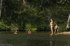 Parents and Children Swimming in the River 6 (C & R Driver-Burgess) Tags: family blue boy sunlight reflection green water girl beautiful swim river dark relax kid dad shadows child little ripple father daughter young mother deep son mum float shad
