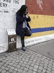Woman, Cigarette burn, Graffiti (kohlmann.sascha) Tags: street people woman streetart building berlin monument wall way deutschland graffiti donna memorial place traffic cigarette wand femme mulher streetphotography technik menschen smoking cobblestones berlinwall graffito frau technique verkehr friedrichshain gebäude youngwoman weg mauer ort berlinermauer denkmal zigarette mensch rauchen murodeberlín thema 女人 kopfsteinpflaster jungefrau jeunefemme murdeberlin 女子 murodeberlim murodiberlino handlung 柏林圍牆 betonmauer concretedam eastsidegalery antifaschistischerschutzwall streetfotografie laseñora strasenfotografie peopleandgraffiti murodeprotecciónantifascista جداربرلين antifascistprotectionrampart же́нщина menschenundgraffiti фра́у בערלינערוואנט murenbéton