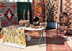 Elaborate Colorful Display (suenosdeuomi) Tags: newmexico santafe fence adorned artisanmarket museocultural canons90
