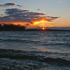 076/366 (local paparazzi (isthmusportrait.com)) Tags: blue sunset red orange lake water clouds eos 50mm prime pod aperture pretty glow iso400 f14 awesome pillar orb windy stunning glowing usm madisonwi liquid epic ef 2016 lakemonona gusting 50mmf14usm danecountywisconsin 366project canon5dmarkii localpaparazzi redskyrocketman lopaps isthmusportrait