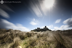 Castle Bamburgh, Northumberland (Silent Eagle  Photography) Tags: longexposure blue sky plants cloud sun castle canon photography silent eagle northumberland lee sep northeast leefilters bamburgcastle bigstopper canoneos5dmarkiii silenteagle09