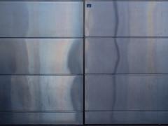 1/081 (Cosimo Matteini) Tags: reflection london metal pen olympus panels northgreenwich 1081 m43 mft ep5 cosimomatteini mzuiko45mmf18