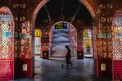Man walking by Mahar Thatkyarthiha Pagoda (Guille Ibanez) Tags: pagoda southeastasia burma buddhist mirrors buddhism fujifilm myanmar colourful mandalay pilgrim chinlon fujixt1