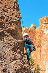 Rock Climbing (Gary Grossman) Tags: statepark people nature oregon centraloregon mountainclimbing climbing pacificnorthwest redrocks climber rockclimbing humaninterest smithrocks garygrossmanphotography shotsofawe