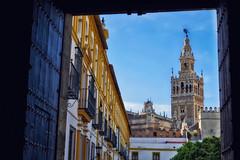 Giralda (Don Csar) Tags: street door espaa tourism buildings sevilla spain europa europe seville andalucia frame giralda