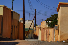 Omami streetscene (Neal J.Wilson) Tags: travel houses streets dusty buildings nikon colours gulf middleeast dry poles roads oman streetscenes omani dirttracks d3200 telegragh