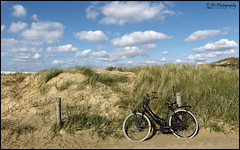 Off to the beach... (E-PIC Photography by Johan Pape) Tags: travel colour beach bike clouds landscape dunes ngc duinen hdr fiets bycicle