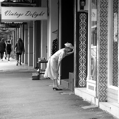 Vintage Delight (Max Milkovitsch) Tags: street old blackandwhite bw woman hat contrast vintage square flickr pattern fuji dress candid streetphotography tags views faves frock newtown f4 comments x30 leadinglines