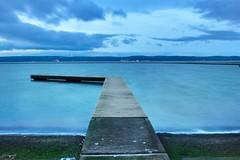 Dawn breaks (cathbooton) Tags: longexposure lake wales canon dawn jetty hills wirral westkirby