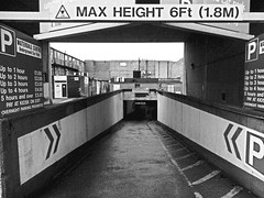 Driving Underground. (ManOfYorkshire) Tags: bw monochrome underground concrete construction parking down olympus 1960s carpark height slope charges headroom 18m digitalgrain diriving
