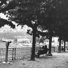 Cernobbio.4 (jean matthieu) Tags: light vacation sky people blackandwhite bw sun white lake holiday black como tree art film water vintage landscape fun photography grey lomo lomography italia artistic weekend perspective line come italie dolcevita argentique cernobbio italiana filmphotography argentic